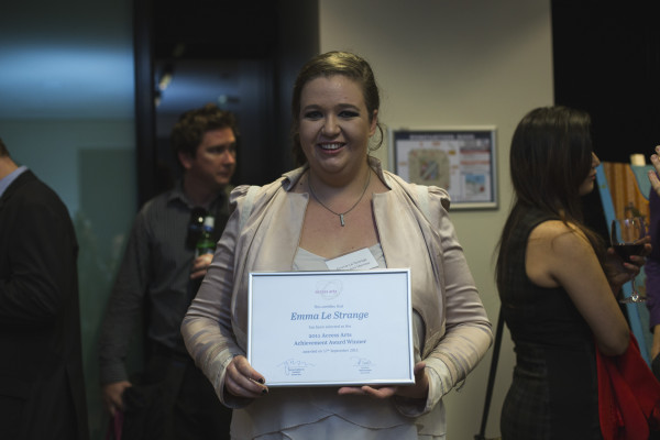 Emma Le Strange holding her new certificate.