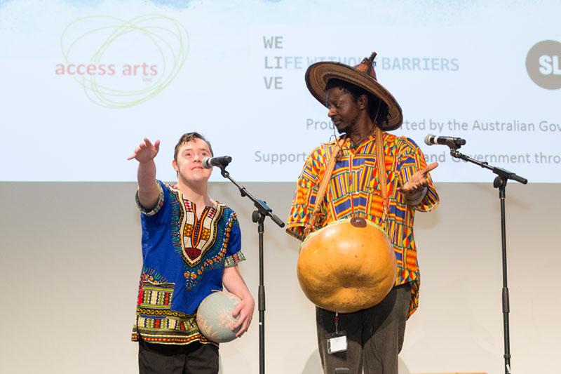 Alexander Procopis performing with Zimbabwean musician Tichawona Noble Mashawa