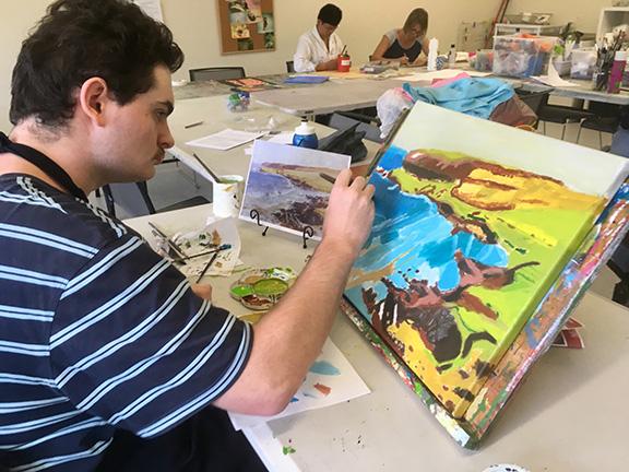 Luke Johnson painting a landscape