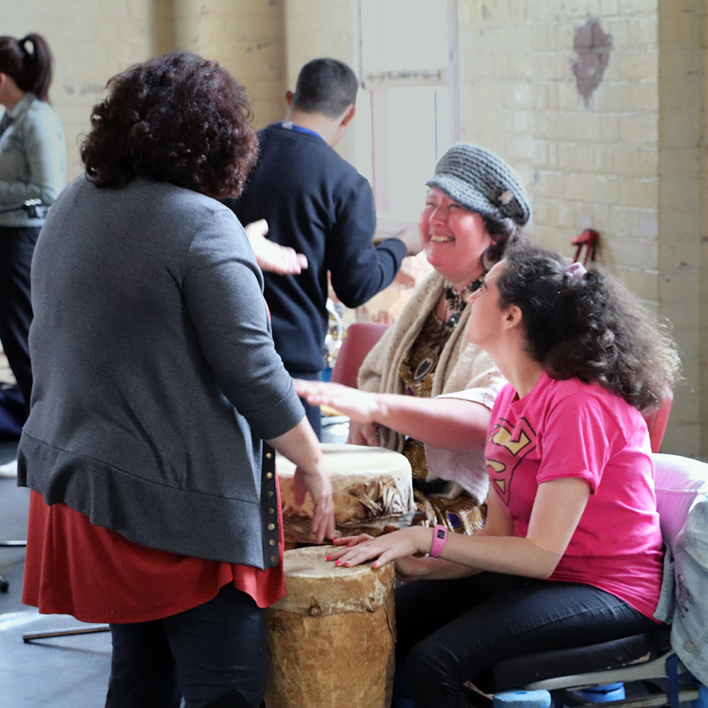 Participants at a drumming workshop in the Brisbane Powerhouse Stores