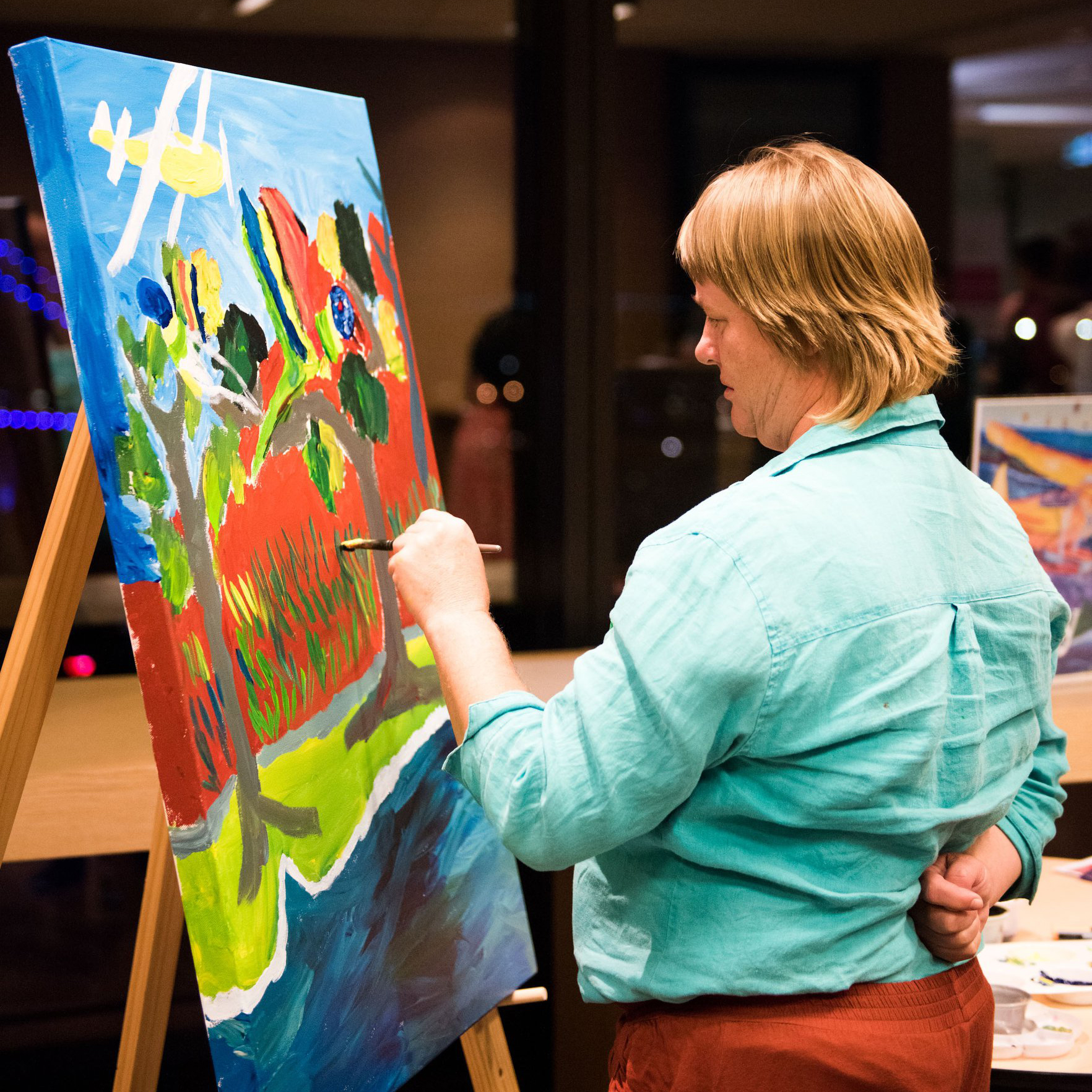 Artist Belinda Peel painting a canvas