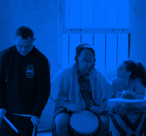 Blue washed image of three people drumming