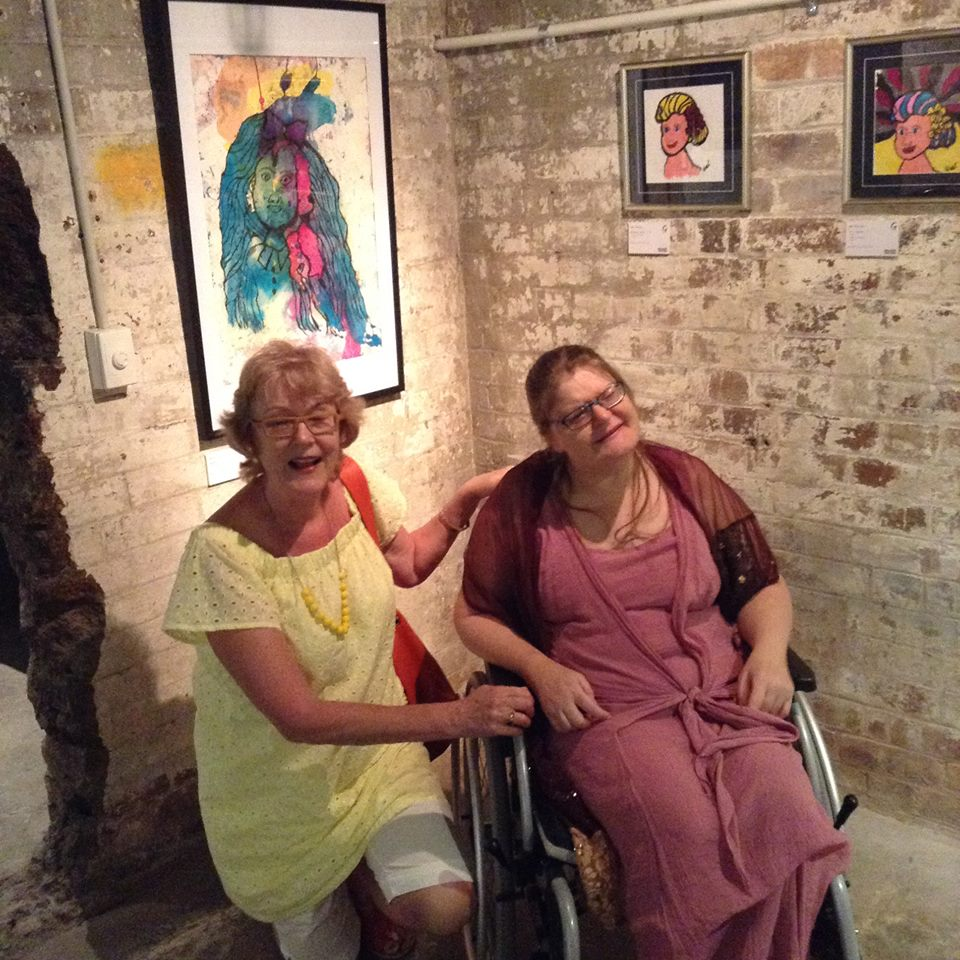Pat Swell and Deb photographed together at an art exhibition